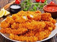 Рецепта Домашни печени пилешки хапки от филе с майонеза и корнфлейкс печени на фурна